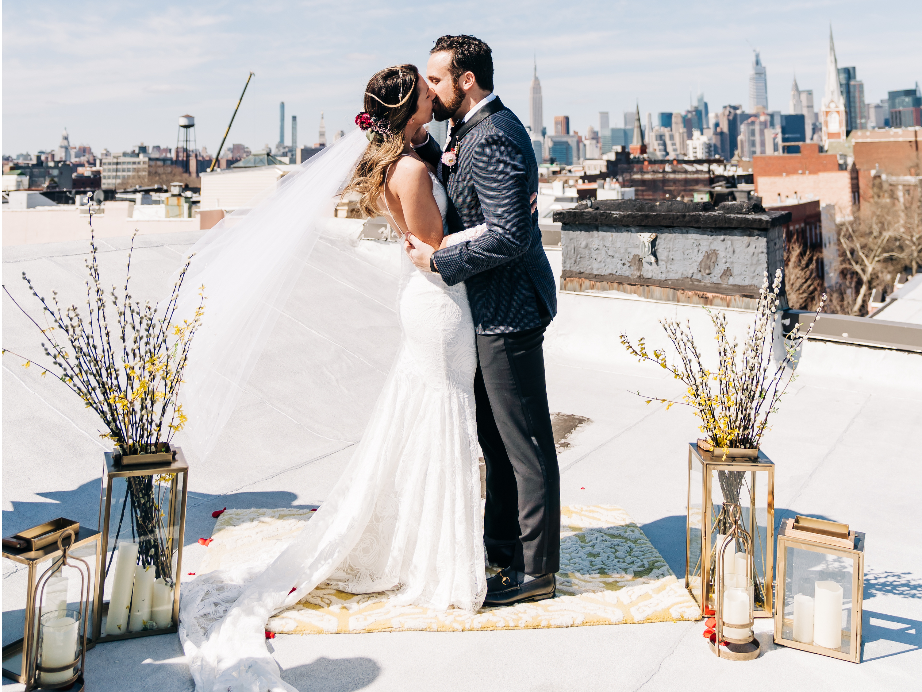 A New York couple got married on their roof after postponing their 200-guest wedding, and the pictures are stunning
